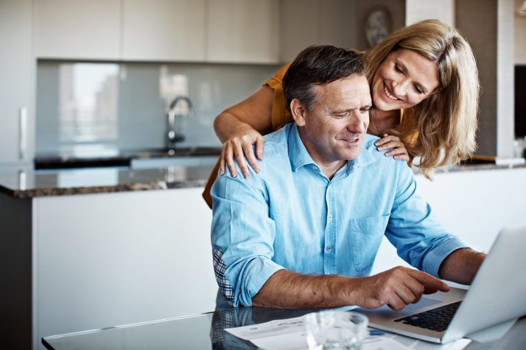 Couple reviewing website